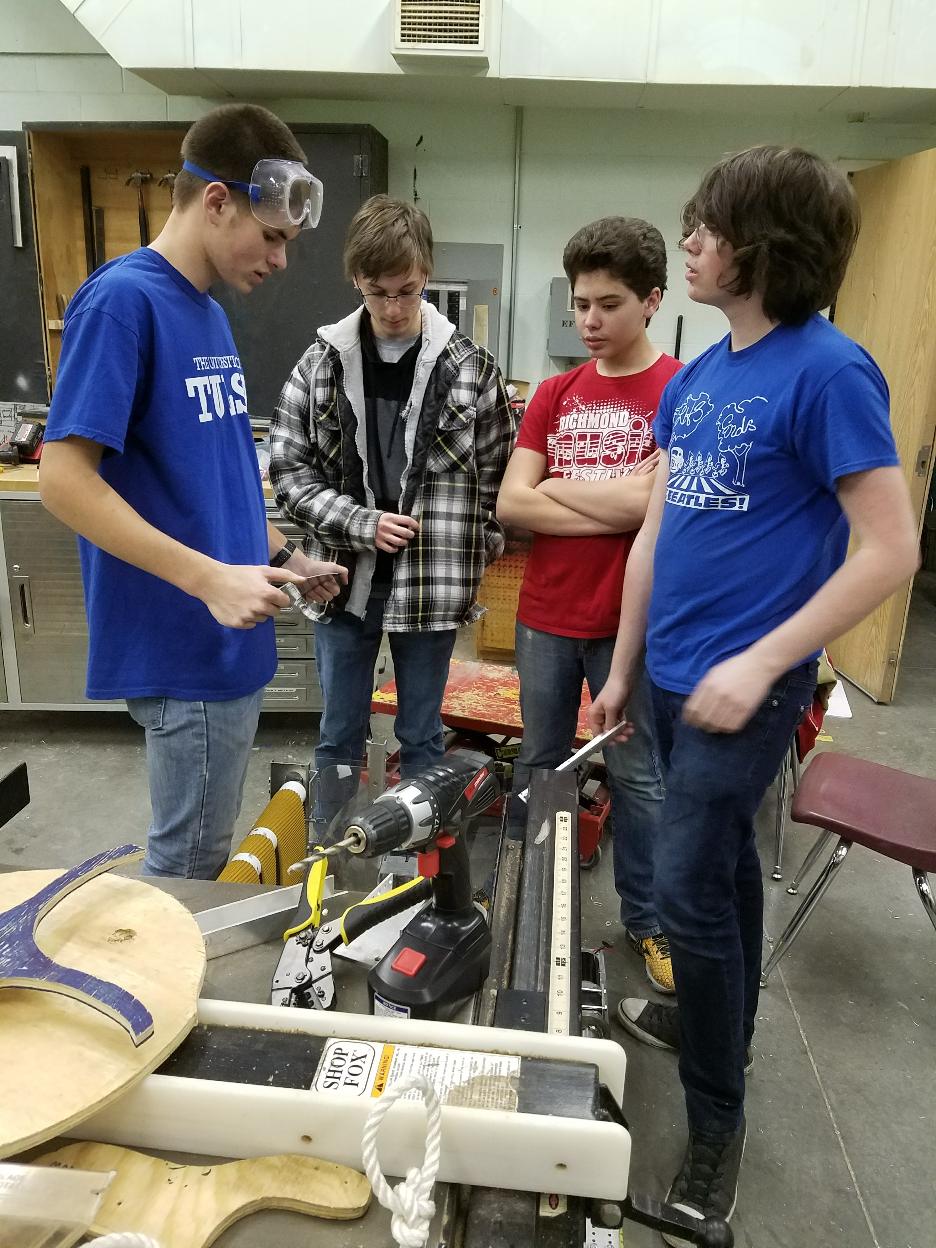 From left to right, Evan Dahlor, Zach Durbin, Ian Mace, and Hunter Mace standing on our robot.